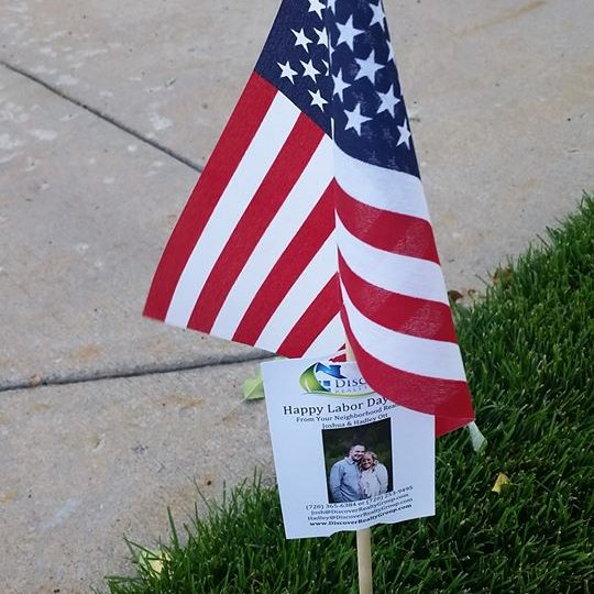 Labor Day Discover Realty Group flags in Highlands Ranch